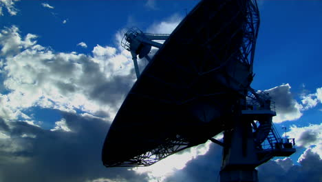 A-Satellite-Dish-Is-Silhouetted-Against-The-Sky