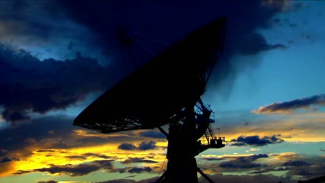 A-Satellite-Dish-Moves-In-Time-Lapse-Against-A-Beautiful-Sky-2