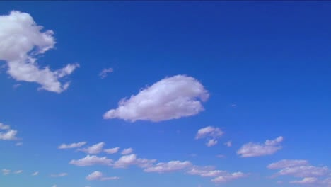 Time-Lapse-Clouds-Moving-Against-A-Blue-Sky