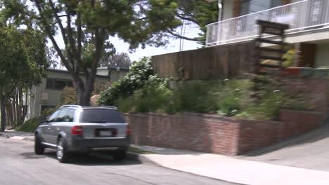 A-Car-Travels-Along-A-Street-In-Santa-Monica-California-As-Seen-Through-The-Rear-Window-At-An-Angle