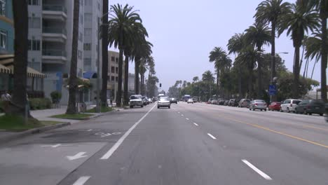 A-Car-Travels-Along-A-Street-In-Santa-Monica-California-As-Seen-Through-The-Rear-Window-2