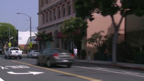 A-Car-Travels-Along-A-Street-In-Santa-Monica-California-As-Seen-Through-The-Rear-Window-At-An-Angle-1