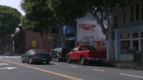 A-Car-Travels-Along-A-Street-In-Santa-Monica-California-As-Seen-Through-The-Rear-Window-At-An-Angle-2
