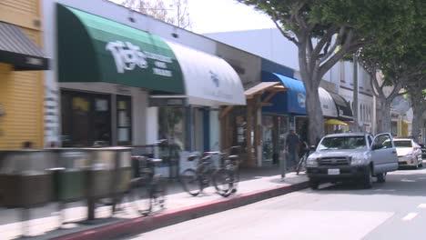 A-Car-Travels-Along-A-Street-In-Santa-Monica-California-As-Seen-Through-The-Rear-Window-At-An-Angle-4