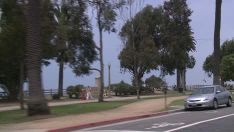 A-Car-Travels-Along-A-Seaside-Street-In-Santa-Monica-California-As-Seen-Through-The-Rear-Window-At-An-Angle-1