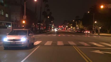 A-Car-Travels-Along-A-Street-At-Night-In-Santa-Monica-California-As-Seen-Through-The-Rear-Window