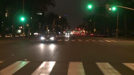 A-Car-Travels-Along-A-Street-At-Night-In-Santa-Monica-California-As-Seen-Through-The-Rear-Window-1