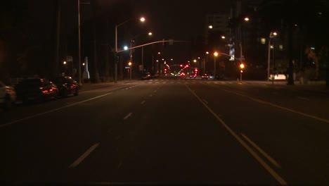 A-Car-Travels-Along-A-Street-At-Night-In-Santa-Monica-California-As-Seen-Through-The-Rear-Window-2