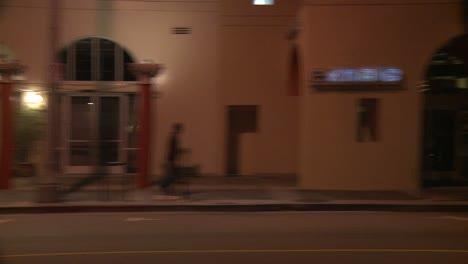 A-Car-Travels-Along-A-Street-At-Night-In-Santa-Monica-California-As-Seen-Through-The-Side-Window