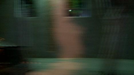 A-Car-Travels-Along-A-Street-At-Night-In-Santa-Monica-California-As-Seen-Through-The-Side-Window-4