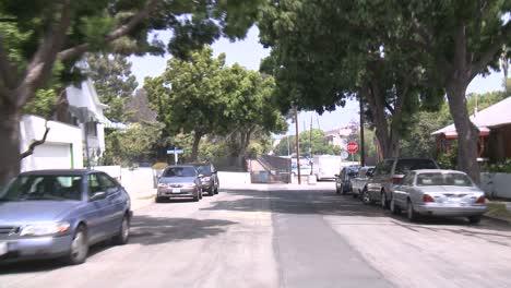 A-Car-Travels-Along-A-Street-In-Santa-Monica-California-As-Seen-Through-The-Rear-Window-5