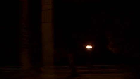 A-Car-Travels-Along-A-Street-At-Night-In-Los-Angeles-California-As-Seen-Through-The-Side-Window-2