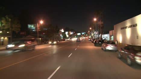 Pov-Of-A-Car-Traveling-Along-A-Street-At-Night-In-Los-Angeles-California-1
