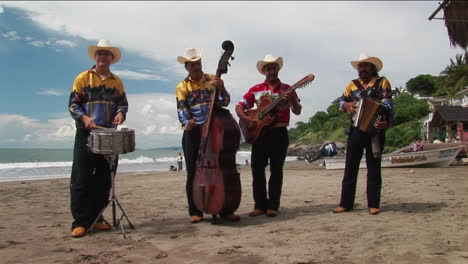 A-mariachi-band-plays-on-a-beach