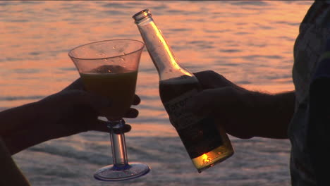 A-couple-makes-a-toast-to-the-ocean