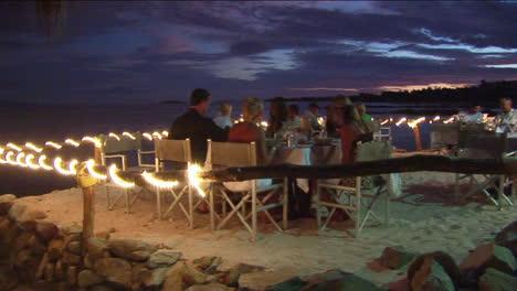 Patrons-dine-at-an-outdoor-beach-restaurant-1