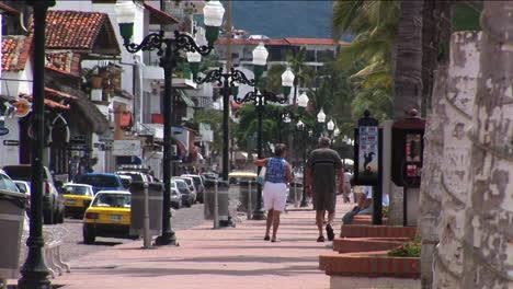 Pedestrians-walk-on-a-sidewalk