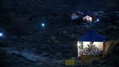 People-ride-bicycles-at-night-at-a-campsite
