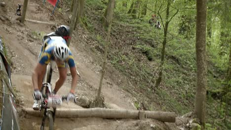 Bicyclists-race-through-a-wooded-area