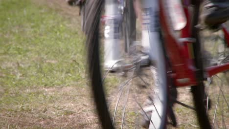 Dozens-of-bikers-race-on-a-rough-course-terrain