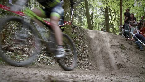 A-group-of-bikers-race-down-an-off-road-trail