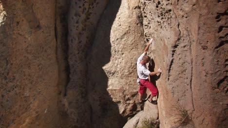A-man-climbs-a-rock-face
