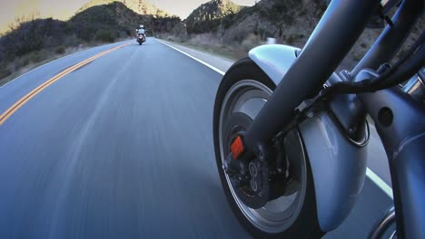 Motorcyclists-ride-down-a-mountain-highway