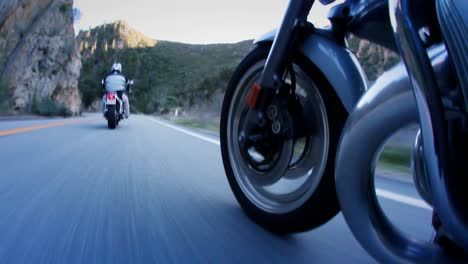 Motorcyclists-are-riding-down-a-mountain-highway