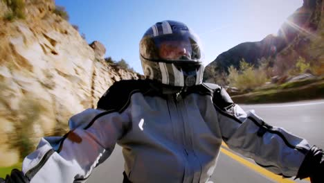 A-man-rides-a-motorcycle-in-the-country-side
