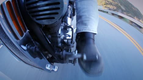 A-motorcycle-is-ridden-down-a-street