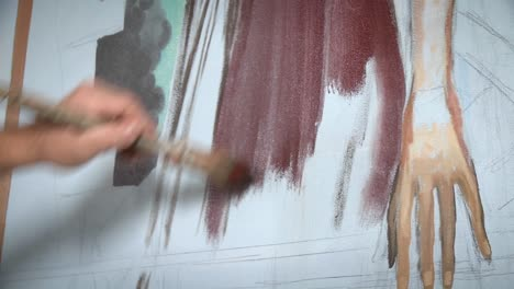 An-artist-works-on-a-painting