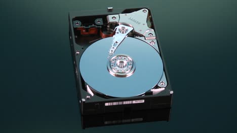 Hard-drive-without-cover-spins-slowly-around