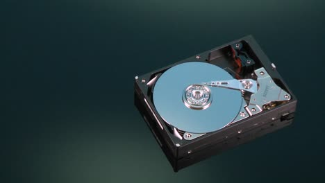 A-hard-drive-without-its-cover-rotates-on-display
