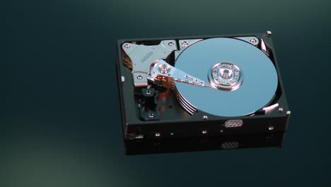 A-hard-drive-with-out-its-cover-pans-by