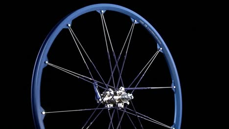 A-blue-wheel-with-spokes-revolves
