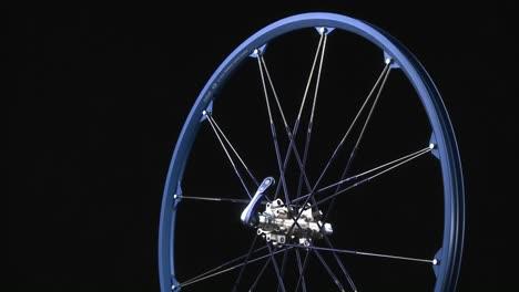 A-blue-bicycle-rim-rotates-around