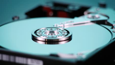 A-hard-drive-with-out-cover-spins-slowly-on-display