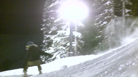 A-snowboard-rider-hits-a-jump-at-night