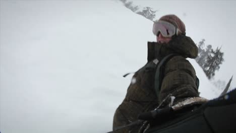 A-snowboarder-records-himself-while-boarding-down-a-slope