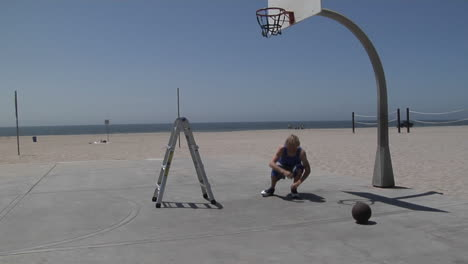 A-basketball-player-slam-dunks-while-standing-on-a-step-ladder
