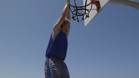 A-basketball-player-slam-dunks-while-standing-on-a-step-ladder-1
