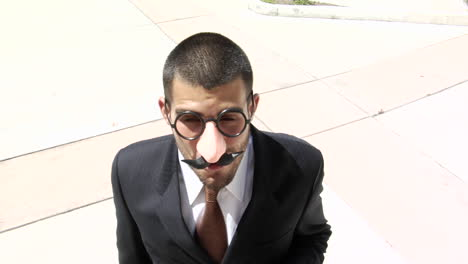 A-businessman-smokes-a-cigar-wearing-a-Groucho-Marx-style-face-mask