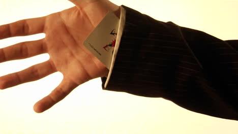 A-man-tucks-a-playing-card-into-his-shirt-sleeve