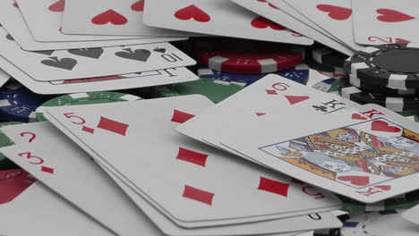 Playing-cards-and-poker-chips-scattered-over-a-card-table