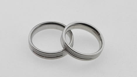 -silver-wedding-rings-overlap-each-other