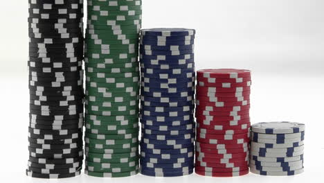 Stacks-of-poker-chips-sit-in-a-row-arranged-by-value