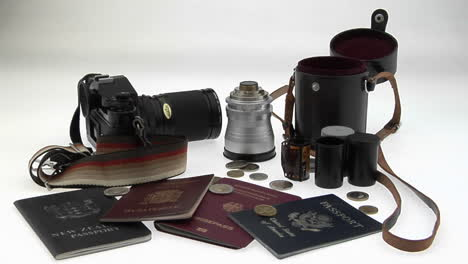 Travel-and-photography-equipment-sit-on-a-white-surface
