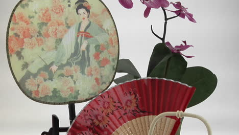A-Japanese-tea-set-is-framed-by-a-Japanesestyle-fan-and-flowers