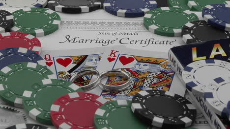 A-marriage-certificate-sits-nestled-under-playing-cards-and-poker-chips