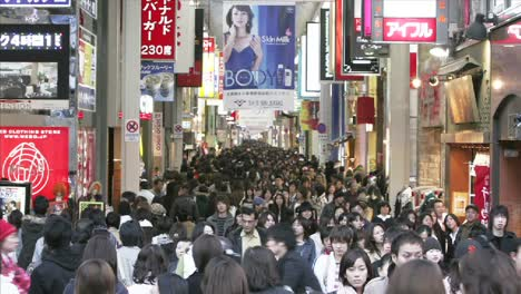 Huge-crowds-of-shoppers-in-a-colorful-pedestrian-mall-in-Osaka-Japan